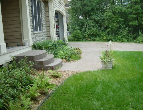 This stair, sidewalk, and driveway are all stamped with the Ashlar Slate stamp.