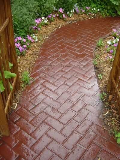 This completed sidewalk uses the Herringbone Brick stamp and the Brick Red color.