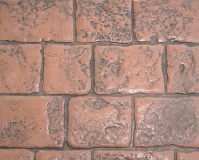 This slab uses the Mayan Cobblestone stamp, the Terra Cotta color, and the Deep Charcoal antiquing release.